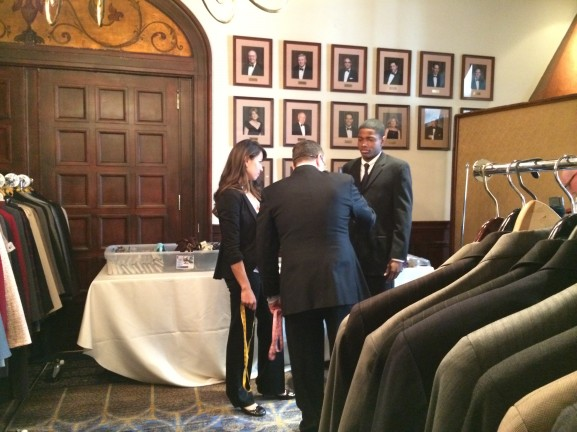 """Veterans get fitted for a donated suit through the """"suiting warriors"""" program."""