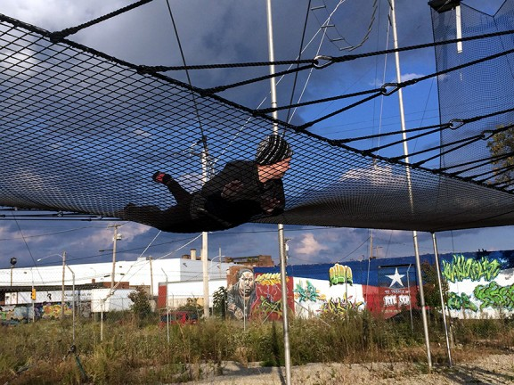 A trapeze student falls into the protective netting at Fly School Circus Arts.