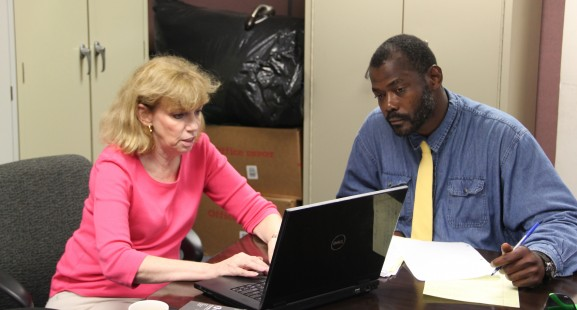 Diane Sandufer works one-on-one with VUB student John Mitchell, helping him gain access to the local network.