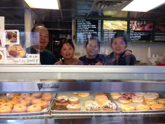 Donald Eap (far left) and his sister Van (far right) standing with two Fresh Donuts' cashiers.
