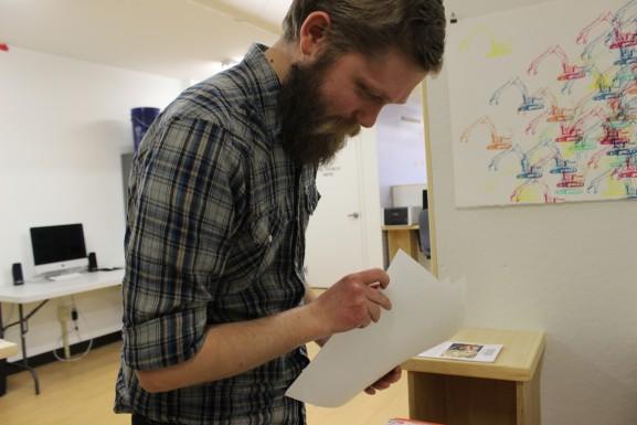 Ian Sampson browsing through some of his artwork.