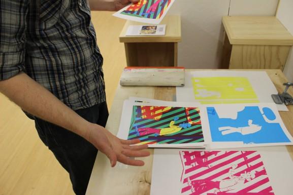 Ian Sampson browsing through some of his art work.