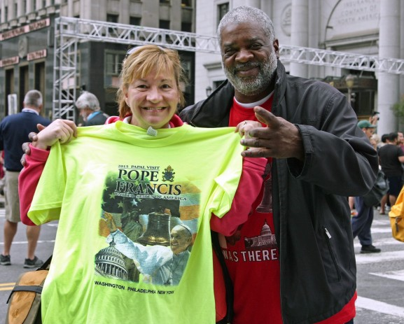 Tourists can't leave Philadelphia without their pope t-shirts after hearing the mass on Sunday, September 27, 2015.