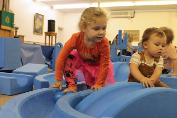 Kids play on blocks won by Fishtown Playschool from the Imagination Playground program.