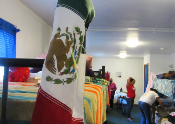 A Mexican flag hangs on the bedpost in one of the women's rooms.