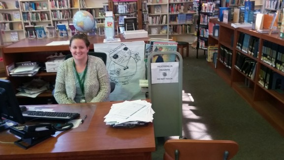 Rachel Solomon, child librarian specialist, working to log the rest of the books.