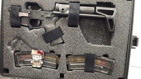 Jose's AR-15 case with Hello Kitty patch.