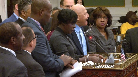 Brown looks on during a City Council session.