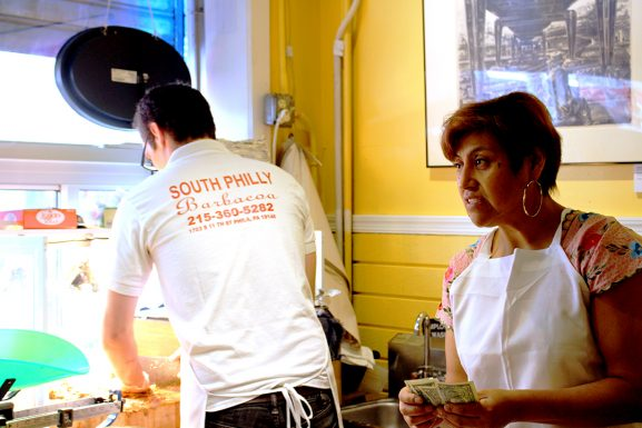 Ben Miller prepares tacos at El Compadre with wife and co-owner Critsina Martinez.