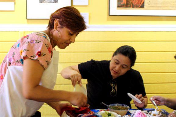 Cristina Martinez serves a customer in El Compadre