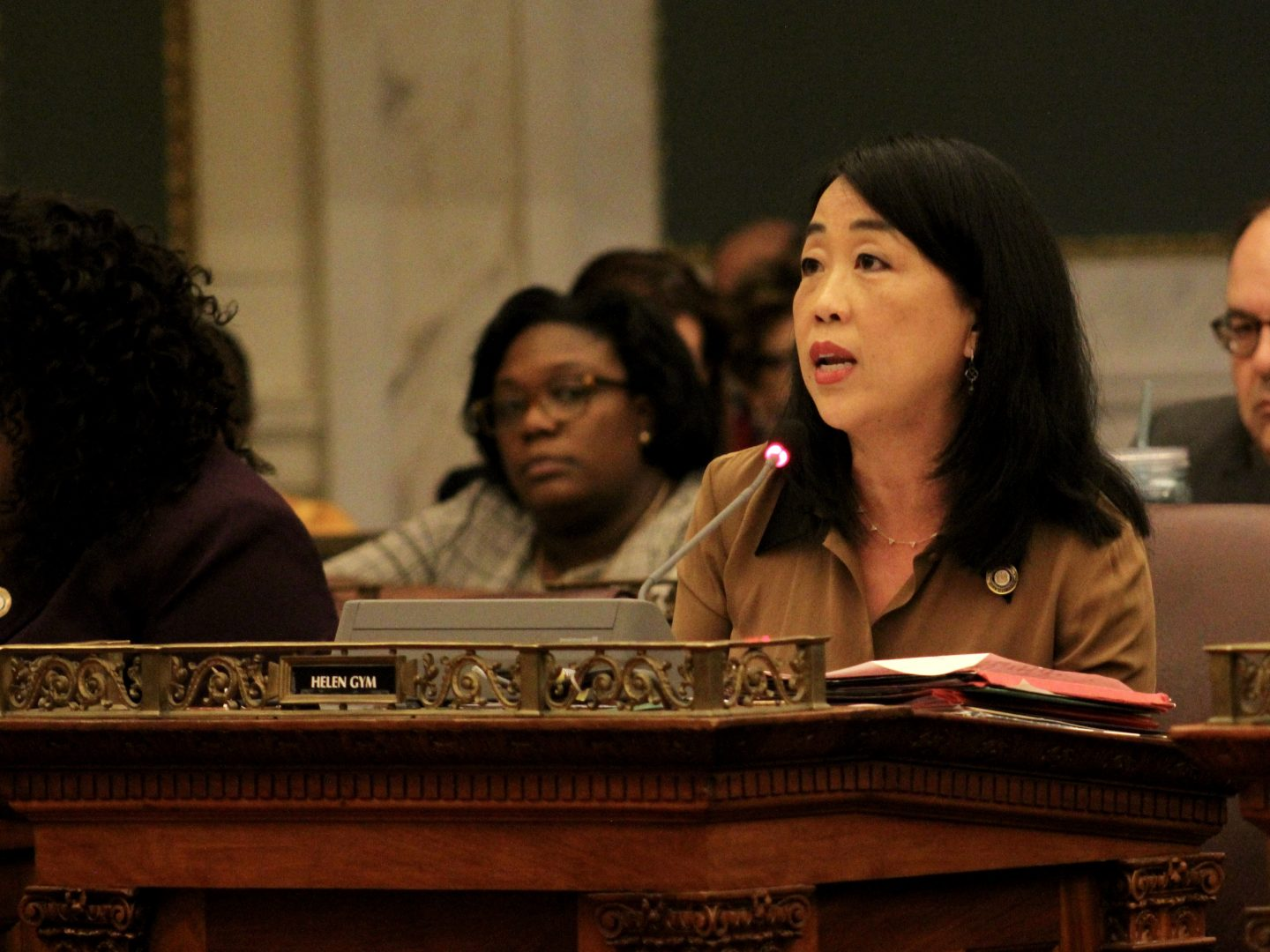 Councilmember Helen Gym speaks into a microphone.